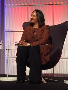 Dr. Kimberley Perkins-Davis seated on stage