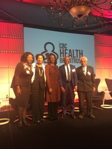 Dr. Kimberley Perkins-Davis on stage with a group of other people