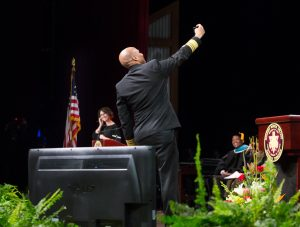 Surgeon General takes a selfie onstage at Convocation.