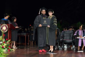 School of Graduate Studies & Research graduate receives diploma.