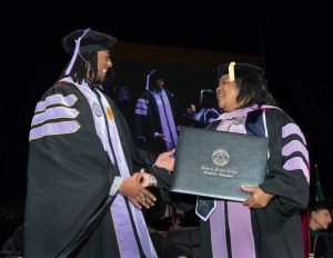 School of Dentistry graduate receives diploma.