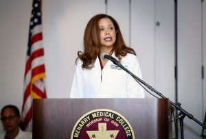 Brenda Lemus, M.D., assistant dean of clinical research, addresses the Class of 2022 during School of Medicine White Coat Day.