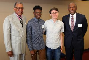 Dr. Churchwell, Sherard Stephens, Derek Doss and Dr. Hildreth smile and pose for a photo.