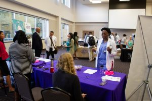Students talk to recruiters at the Career and Residency Fair.