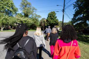 Meharry students and Haywood Elementary educators walk along a community sidewalk.
