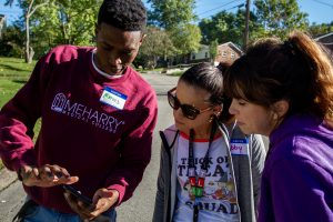 A Meharry student demonstrates the MapplerK2 app to Haywood educators on a community street.