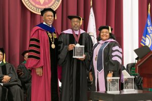 Dr. Henry L. Young Jr. receives the Distinguished Dentist Award.