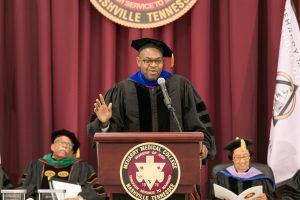 Dr. James Eric McDuffie speaks from the podium after receiving the Distinguished Biomedical Scientist Award.