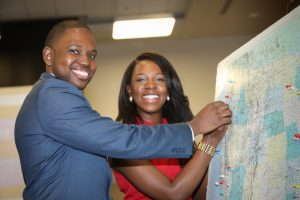 Medical students mark their match on a map with a thumbtack.