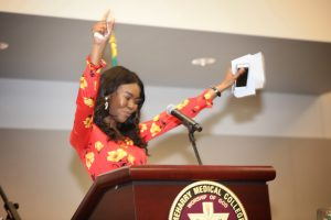 Medical student celebrates their match at a podium.